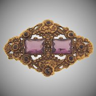 Early 1900's gold tone Brooch in a floral design with purple glass stones