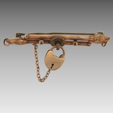 Interesting Edwardian bar gold filled bar pin with dog heads at each end and a center lock