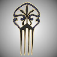 Vintage early plastic hair comb with black enamel and blue rhinestones