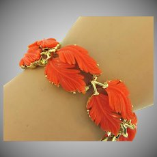 Signed Lisner gold tone link Bracelet with large overlapping tangerine colored large plastic leaves