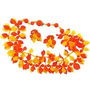 Marked Western Germany set bright plastic Necklace and matching clip back Earrings in bright yellow and orange colors