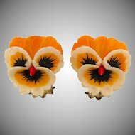 Vintage celluloid small pansy clip back Earrings in yellow, black and red tints