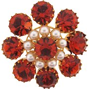 Vintage Brooch with bright orange rhinestones and imitation pearls