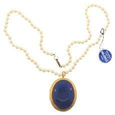 Signed Hobe' imitation pearls with large locket patent dated to 1976