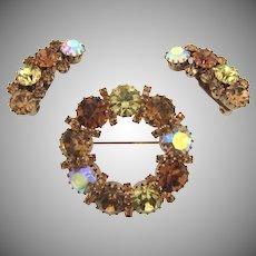 Signed Karu Arke rhinestone Brooch and clip back Earrings in fall colors