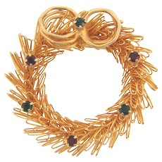 Vintage Christmas wreath Brooch in gold tone wire with red and green rhinestones