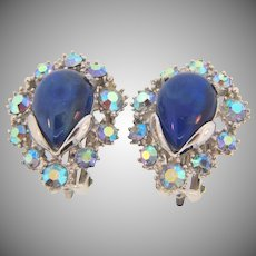 Signed Hollycraft copr 1959 clip back  silver tone earrings with shades of blue glass stones