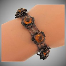 Vintage link copper tone floral Bracelet with amber glass stones
