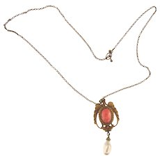 Charming choker length pendant necklace with coral glass stone and imitation pearl drop