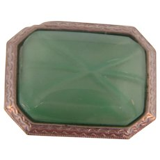Early 1900's small silver tone Brooch with a green glass star sapphire