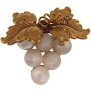Signed Coro figural Brooch with composition moonstone beads