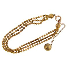 Early triple chain Bracelet with dangling chain ball
