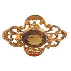Early gold filled ornate Brooch with large faceted citrine stone
