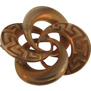 Small early gold filled Lover's Knot Scatter Pin with embossed design