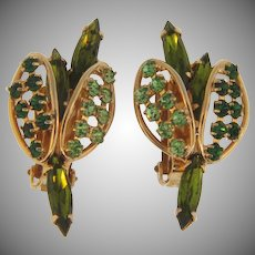 Signed Hobe 1960's rhinestone clip back Earrings in green hues