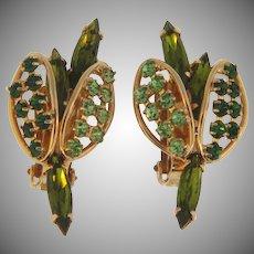 Signed Hobe 1960's rhinestone clip back Earrings in green hues
