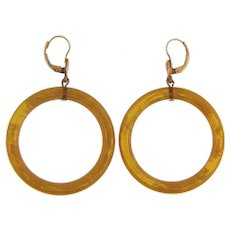 Vintage hoop pierced Earrings in apple juice Bakelite