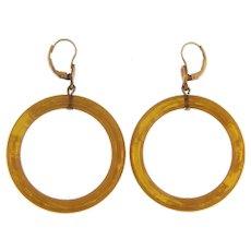 Vintage hoop pierced Earrings in apple juice Bakelite