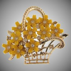 Signed Lisner figural flower basket Brooch with yellow thermoset flowers and crystal rhinestones