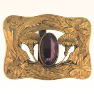 Early floral Belt Buckle with large purple glass stone
