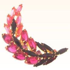 Vintage curved rhinestone Brooch in red to pink tones