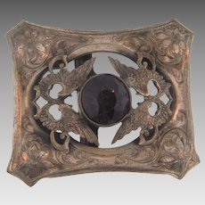 Vintage silver tone Belt Buckle with center deep purple glass stone flanked by wings