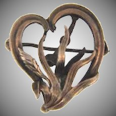 Vintage sterling silver early 1900's watch pin in a heart shaped floral design