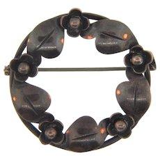 Marked Sterling silver Denmark circular brooch in a floral design
