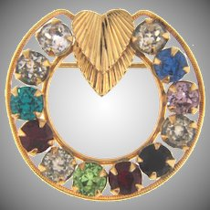 Marked gold filled circular Brooch with multicolored rhinestones