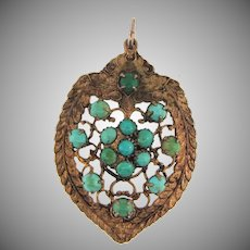Unique Arts and Crafts period pendant with turquoise beads