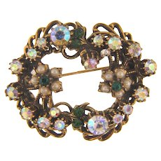 Signed Florenza antiqued gold tone Brooch with AB rhinestones, green rhinestones and imitation pearls