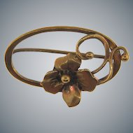 Small vintage gold tone scatter pin with floral design