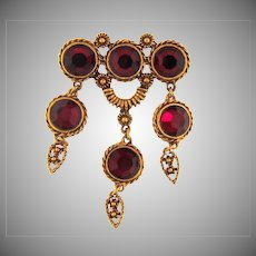 Vintage dangling Brooch with red rhinestones
