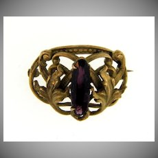 Small early Scatter Pin with deep purple center glass stone