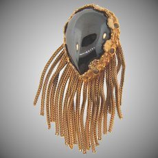 Unusual vintage gold tone Brooch with a large hematite stone and dangling chains