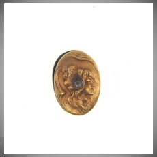 Tiny Art Nouveau lingerie clip of a woman's face with a paste stone