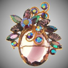 Vintage large rhinestone Brooch with large givre lavender and crystal glass stone topped with a rhinestone floral design
