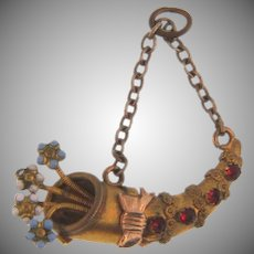Vintage small cornucopia pendant/charm with enamel flowers and red paste stones