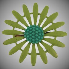 Metal 1960's daisy flower enamel Brooch with green petals and a blue center