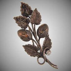 Early silver tone floral stray Brooch with a crystal rhinestone and metal gold wash buds