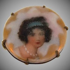Small porcelain Brooch with a lithograph portrait and gilded edges