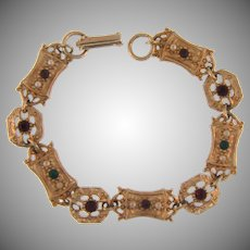Signed Sarah Coventry gold tone link Bracelet with tiny imitation pearls and rhinestones