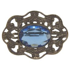 Early silver tone Brooch with faceted blue glass stone