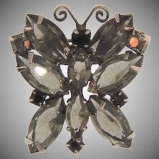 Small figural butterfly Brooch with smokey and black rhinestones