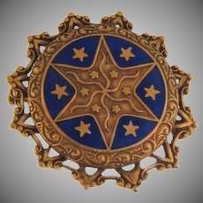 Vintage circular Brooch with center blue enamel and star motif