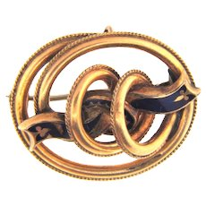 Early gold filled oval Brooch with a blue enamel ribbon