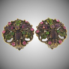 Signed Hollycraft clip back Earrings with purple,green and pink rhinestones