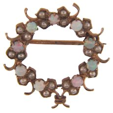 Early gold filled circular Scatter Pin with opals and seed pearls