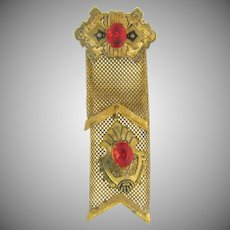 Vintage mesh medal Brooch with taille de epergne and early plastic red cabochons