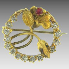 Small early Scatter Pin with floral center and paste stones